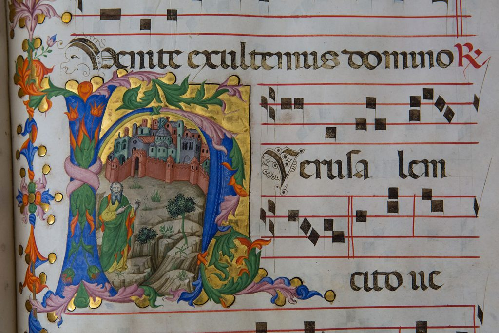 "Choir Books of the Franciscans of Bethlehem Tempera, gold, and ink on parchment Andrea di Bartolo (active in Siena and Venice, 1380–1429) and workshop Ca. 1401–4, Venice Terra Sancta Museum, Bibliotheca Custodialis, Jerusalem In presenting these massive and colorful books to the Franciscan community in Bethlehem, Henry IV of England (1367–1413) asked that they pray for the soul of his father. The friars' daily routine followed a rhythm of communal prayer and singing, reflected in these volumes. The Prophet Isaiah, in a Letter H The prophet Isaiah stands outside the walls of Jerusalem, as the hymn proclaims: ""Jerusalem, thy salvation cometh quickly; why art thou wasted with sorrow? . . . Fear not, for I will save thee"