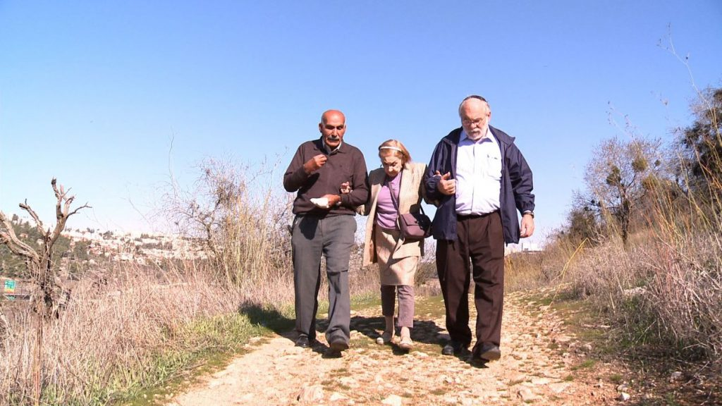 Yacoub Odeh, Dasha and Menachem walk the path of peace in the deserted village