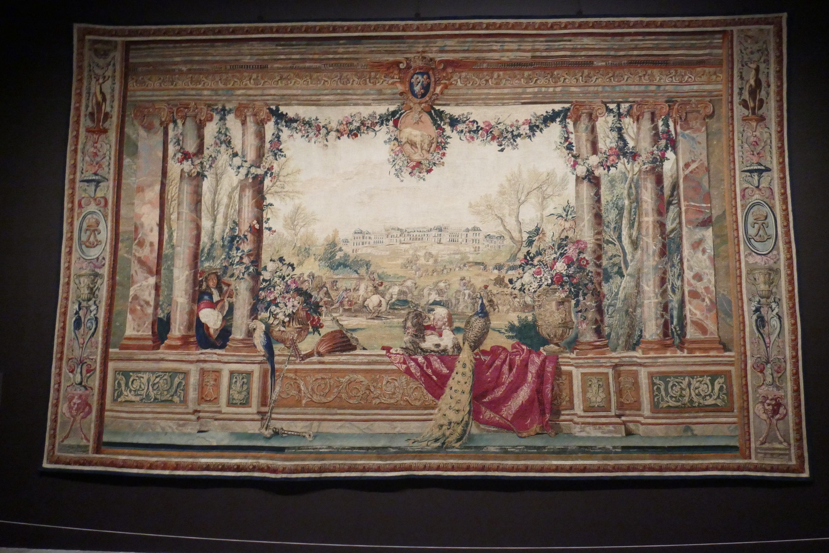 The vast tapestry hung at the beginning of Visitors to Versailles