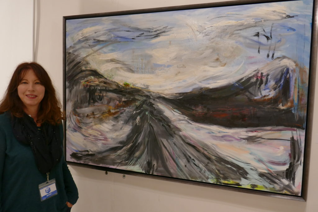 LauraLee Franco beside her Storm Fear (2017) Oil paint charcoal 60